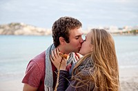 Spain, Mallorca, Couple kissing on beach