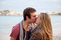 Spain, Mallorca, Couple kissing on beach