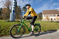 Germany, Bavaria, Harmating, Mature man riding bicycle