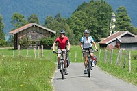 Germany, Bavaria, Zwergern, Man and woman riding bicycle