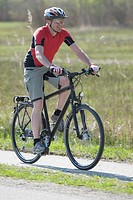 Germany, Bavaria, Mature man riding bicycle