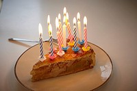 Germany, Cologne, Birthday cake with candles in apartment