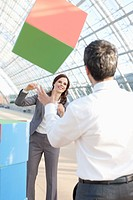 Germany, Leipzig, Business people playing with cubes (thumbnail)