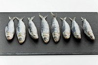 Sardines on chopping board