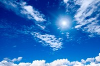 White clouds with sun in blue sky