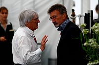 Bernie Ecclestone GBR, President and CEO of Formula One Management with Eddie Jordan IRL