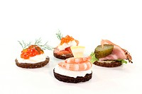 Pumpernickel bread with cream cheese, shrimp, caviar, salmon and smoked bacon