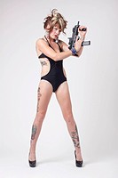 Sexy woman wearing a one_piece swimsuit with an assault gun.