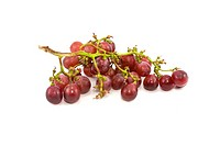 Close up of red grapes isolated on white background