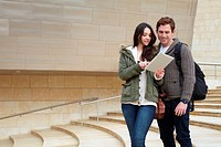 Young couple looking digital tablet in the city, digital tablet, Guggenheim Museum, Abandoibarra, Bilbao, Bizkaia, Basque Country, Spain