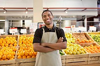 Worker smiling in supermarket