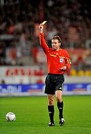 Referee Dr. Felix Brych, showing yellow card, 1. FC Koeln, warning, Mercedes_Benz Arena, Stuttgart, Baden_Wuerttemberg, Germany, Europe