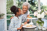 Older woman and granddaughter having pie