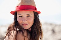 Woman wearing straw hat outdoors