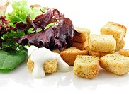 seasoned croutons and salad leaves , close up