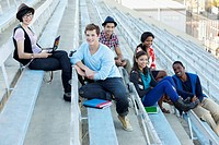 Students sitting on bleachers together