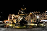 Bronze fountain in Praca Rossio square at night, Baixa, Lisbon, Portugal, Europe