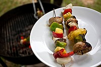 Haymarket, Virginia, United States of America..Cooked vegetable skewers are places on a plate after being grilled.