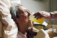 people, old age, retirement home, Altenzentrum der St Clemens Hospitale in Sterkrade, older woman lies in a sickbed, aged 70 to 85 years, physical han...
