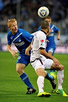 Duel between Andreas Ibertsberger of TSG 1899 Hoffenheim, at back, and Itay Shechter, 1. FC Kaiserslautern, at front, Fabian Johnson at far back, TSG ...