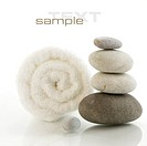 Stone tower and white towel with reflection on white background with sample text