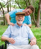 Disabled senior man enjoying a relaxing massage from his physical therapist.