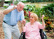 Happy senior couple conquering the challenge of her disability together.