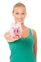 Young beautiful woman standing with piggy bank money box, isolated on white background