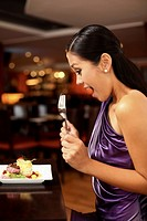 Woman looking happily at her food