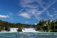View of the Rhine Falls of Schaffhausen, little excursion boat at front, Schloss Laufen Castle at the Rhein Falls, Switzerland, Europe