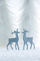 two decorative reindeer in a Winter landscape.Winter wonderland / together at Christmas