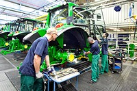 Assembly of doors in the tractor production section at the European headquarters of the American agricultural machinery manufacturer John Deere, Deere...