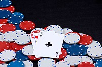 Gambling chips with poker cards