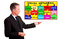 Senior business man explaining social networks with a chart