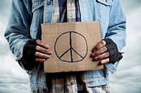 homeless man with cardboard, selective focus on nearest part