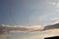 Heart drawn on sky by airplanes.