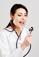 An image of young doctor shouts in a stethoscope