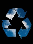 A recycle symbol cutout on a blue sky