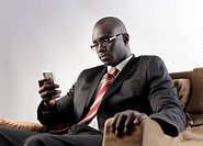 African businessman using a mobile phone