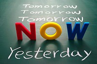 Now, yesterday, and tomorrow words on blackboard, Time concept.