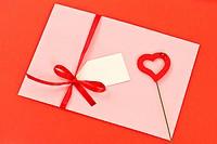 Valentine envelope on red background