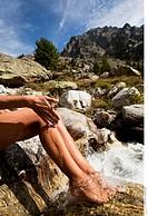 Woman legs river