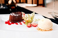Chocolate fondant with vanilla ice cream and raspberry sauce
