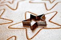 Baking star shape christmas cookies, selective focus