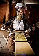 Old Kayan woman weaving, near Lake Inle, Burma also known as Myanmar, Southeast Asia, Asia
