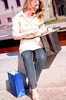 Blonde Woman looking in her Shopping Bag