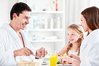 Happy family at breakfast in the kitchen