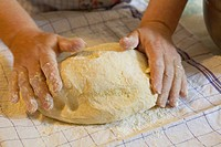 Woman´s hands kneading pastry dough