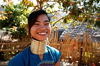 Smiling Longneck girl outdoors Approximately 300 Burmese refugees in Thailand are members of the indigenous group known as the Longnecks The largest o...