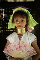 Portrait of a young Longneck girl with a fan Approximately 300 Burmese refugees in Thailand are members of the indigenous group known as the Longnecks...